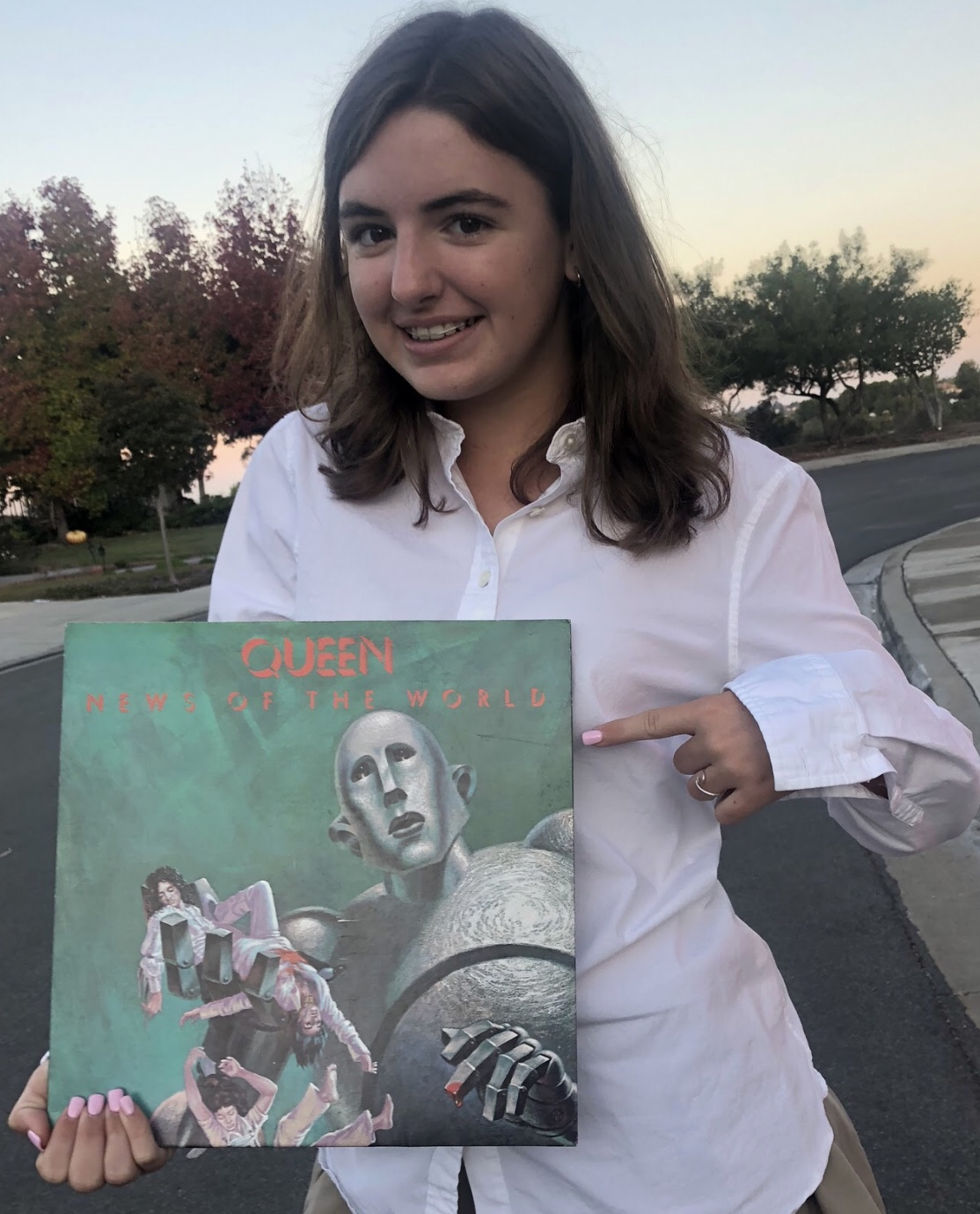 Cathedral Catholic High School student Megan Garvey '22 holds a Queen record as she prepares to view the upcoming film, Bohemian Rhapsody, which describes Mr. Freddie Mercury's life and his journey while leading Queen on its path to fame.