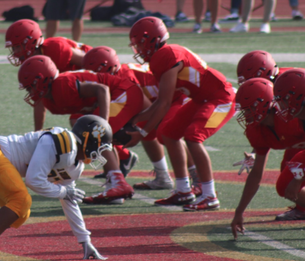 Junior+varsity+center+Nick+Salda%C3%B1a+%E2%80%9821+snaps+the+ball+to+quarterback+Luke+Scornovaco+%E2%80%9821+during+the+recent+CCHS+vs.+El+Camino+game%2C+which+resulted+in+a+47-0+win+for+CCHS.%0A
