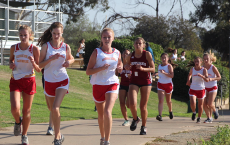 Grace Whitty '20 (left), Morgan Laney '21, and Margot Wesselman '21 lead a section of the junior varsity girl's League Finals race, the last meet of the regular cross country season.