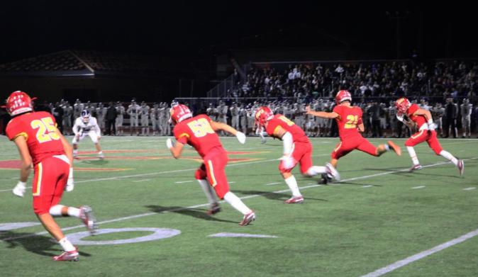 Dean Janikowski '19, Cathedral Catholic High School varsity football kicker, kicks off on Friday night against Carlsbad High School.