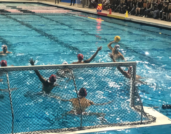 The Cathedral Catholic High School waterpolo team defends the net from an opposing goal on Saturday in the CIF championships. Goalie Andrew Kuypers '19 had 17 saves, which contributed to the win for the Dons.