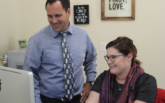 Administrative assistant of mission and ministry Mrs. Mallory Sigmon and assistant Dean of Mission and Ministry Mr. Jeff Gramme plan the next LIGHT group lesson for December.
