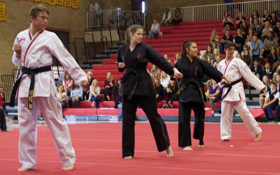 Cathedral Catholic High School Taekwondo Club founders perform during Dons Day for visiting eighth graders.