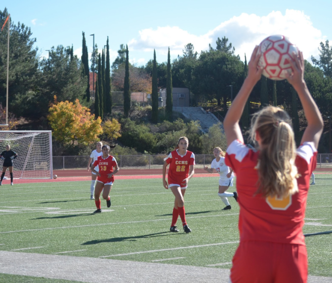 Kelsey Branson '22 (right) looks up the field to throw in the ball, as Danica Chargulaf '20 (left) and Sophia Aragon '21 (center) make cuts, opening space in order to receive the ball in their soccer game against Mater Dei on Friday as a part of the twelfth annual Butch Lee Tournament. The Lady Dons went on to lose against Mater Dei, but won against University City High School, Poway High School, and Canyon Crest Academy.