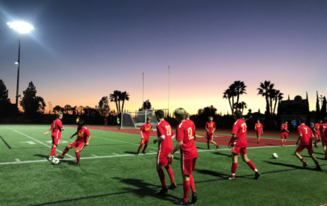 The boys varsity soccer team warms up their skills at Manchester Stadium Friday evening in preparation to play Bishops High School. After dominating the majority of the game, the Dons took home a 7-1 win against the Knights.