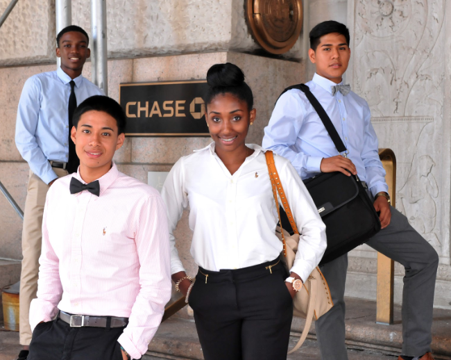 Students+of+a+previously+instituted+Cristo+Rey+school+arrive+to+their+part-time+job+at+Chase+Bank+in+their+efforts+to+receive+a+funded+Catholic+and+college-preparatory+high+school+education.+
