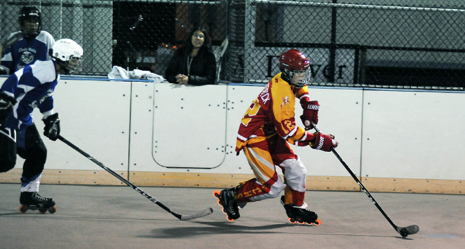 Defender+Ben+Rodenbeck+%E2%80%9820+moves+the+puck+down+the+rink+and+to+the+forwards+to+score.