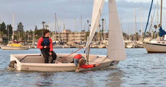 Kyle Gallagher '19 and Claire Backer '21 sail a downwind stint during a practice exhibition race in early December.