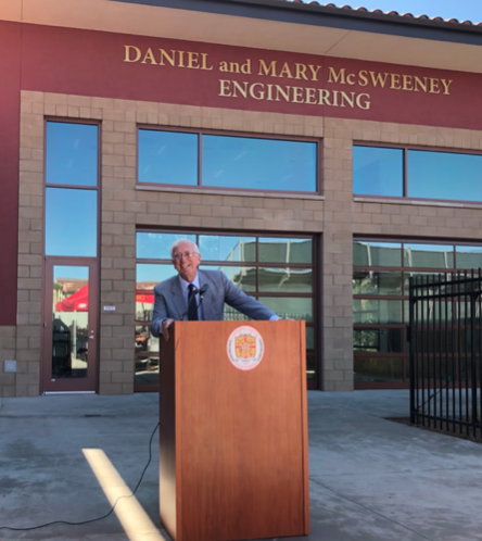 Speaking in front of an audience of approximately 25 people, Mr. Daniel McSweeney explains his motivation behind donating money to build a new engineering building at Cathedral Catholic High School, saying it is