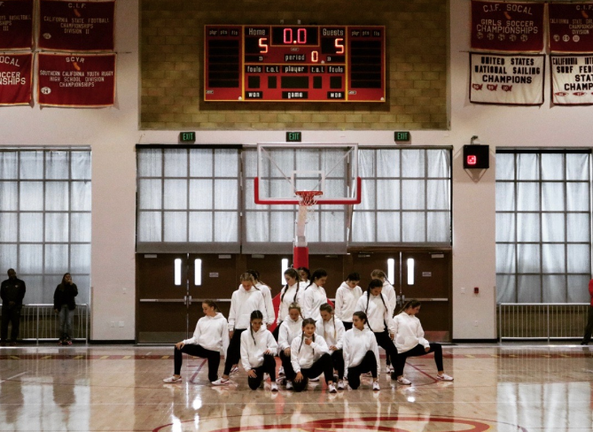 The Cathedral Catholic High School dance team performs at the winter rally on Friday in the Claver Center, kicking it off with school spirit and enthusiasm.