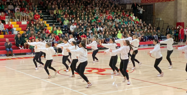 Cathedral Catholic High School varsity dance team pumps up the crowd at last Friday's winter sports rally, preparing it for fun-filled events, such as an Options versus faculty basketball game and a staff flash mob.