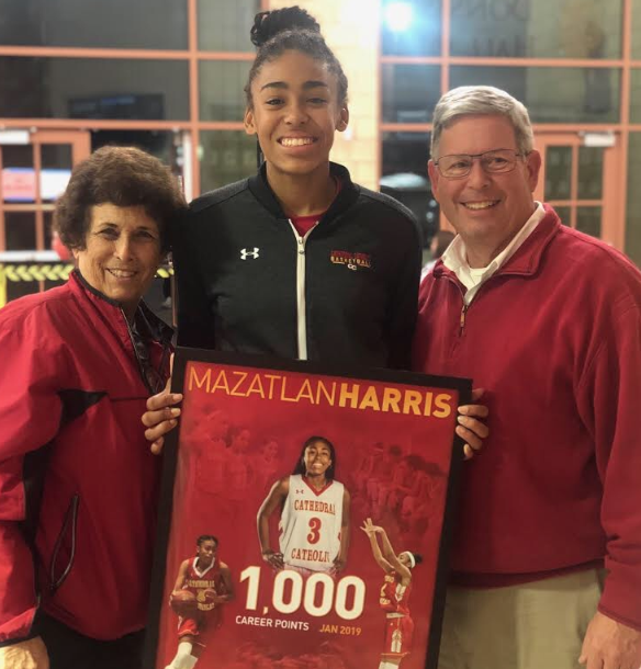 Mazzie Harris '20 (center) poses for a shot with the assistant girls athletic director Ms. Margaret Mauro (left) and CCHS President Mr. Stevan Laaperi (right) after receiving her award for scoring 1000 career points.