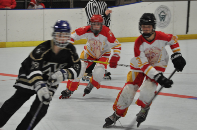 Quinn Conway '22 (#23) charges toward a Westview High School player with teammate Henry Allen '21 (#3) close behind. Although they put in a good effort, the Dons came up short during this game, losing 8-2 to Westview.