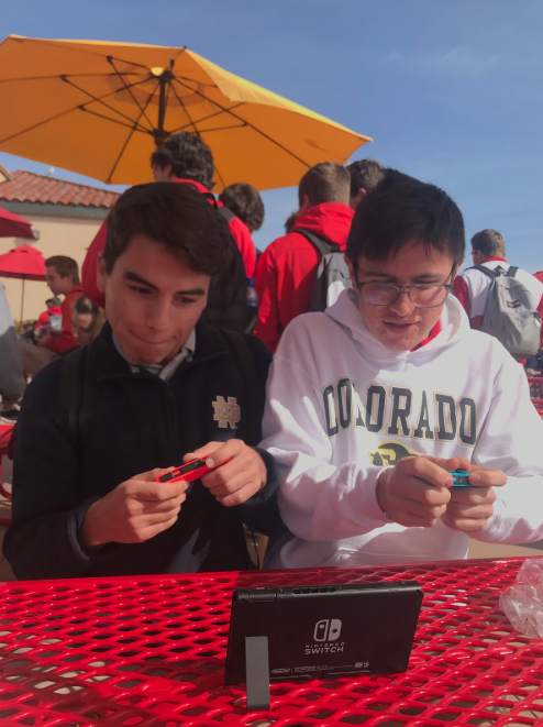 John Teixeira '19 and Daniel Pronko '19 strike up a game of Mario Kart on their Nintendo Switch during lunch.