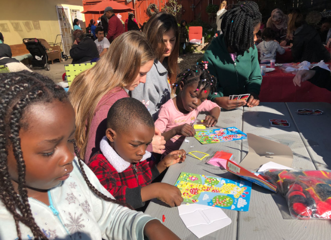 Isabella Smith '19 and Morgan Puglisi '19 guide young children in a craft on Saturday morning during their NHS project titled Bridge of Hope, a non-profit organization dedicated to strengthening families as they transition through trauma, refugee relocation, or homeless.