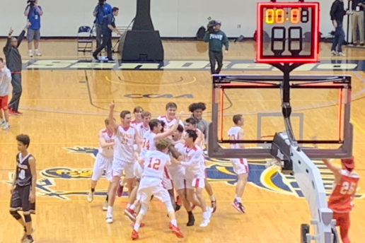 The Cathedral Catholic High School varsity boys basketball team celebrate its CIF Division I championship last Friday against the Francis Parker Lancers seconds after the winning shot made by Obinna Anyanwu '21 just before the buzzer, putting the Dons at a 47-46 win.