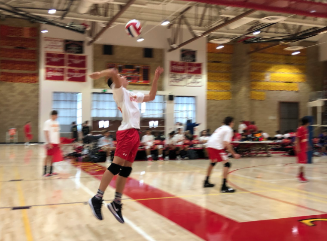 Ryan Napoli '22 spikes the ball during Monday afternoon's junior varsity volleyball game against rivals Saint Augustine High School.