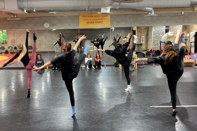 The Cathedral Catholic dance team members switch off practicing dances for their upcoming concert as a way to improve their performance skills.
