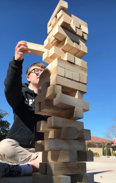 Options student Thomas Byrne '20 builds a Jenga tower with his mentor Coley O'Connor '19 during class Tuesday. As apart of the Options program, Byrne spends some school time building connections with his mentors and playing games outside.