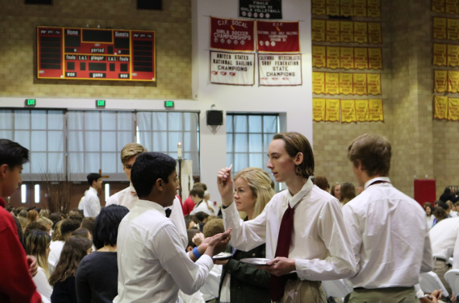 Students receive the Eucharist on Tuesday morning at liturgy to celebrate St. Joseph, the Patron of Cathedral Catholic High School. Father Patrick Wainwright, accompanied by Father Father Martin Latiff and Father Michael Ortiz led the service.
