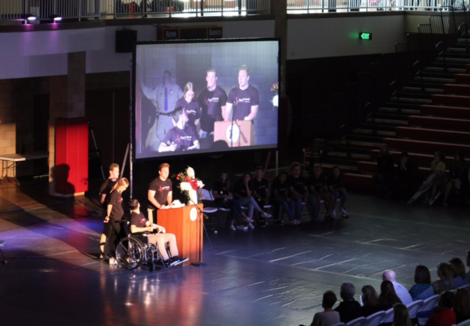 During an all-school assembly Tuesday, CCHS student participants in the 15 Minutes program, Miles McCormick '19, Lauren Munro '19, Caleb Price '19, and Jake Mitten '19 (left to right), reflect on their experience in a DUI car crash demonstration.