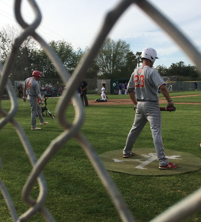 Reagan Guthrie '20 and Nico Ryder '20 (left to right) warm up on Tuesday in preparation to hit against rival St. Augustine High School, which fell in defeat 2-0 to the Dons at Hickman Field. CCHS pitchers and brothers Jake Rons '19 and Cooper Rons '20 posted perfect earned run average of 0.00 in shutting out the Saintsmen.