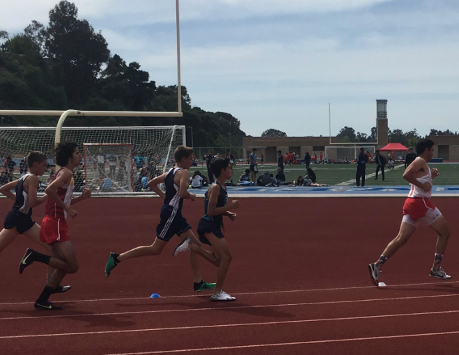 Peter Cresci '20 (right) leads a pack of runners during the 1600m junior varsity race at the University City High School dual track meet on Thursday, where he took third place in the event.