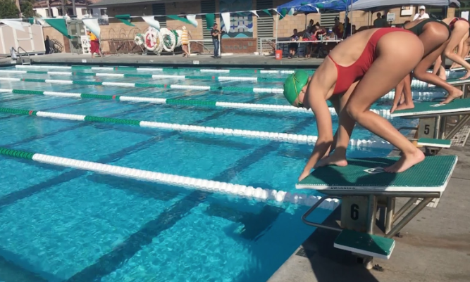Keely Ryan '20 dives off the block to swim the 100-yard butterfly event at the swim meet against Coronado High School on Friday.