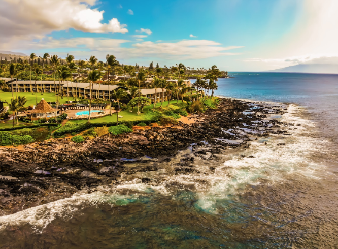 Co-Sports Editor Alex Woodmansee '20 visits Hawaii during spring break with his family to enjoy some time in the warm water and sunny beaches. Woodmansee takes this shot of the Western Maui coastline with his DJI Mavic Air drone last Thursday after a brief rainstorm passed by the island.