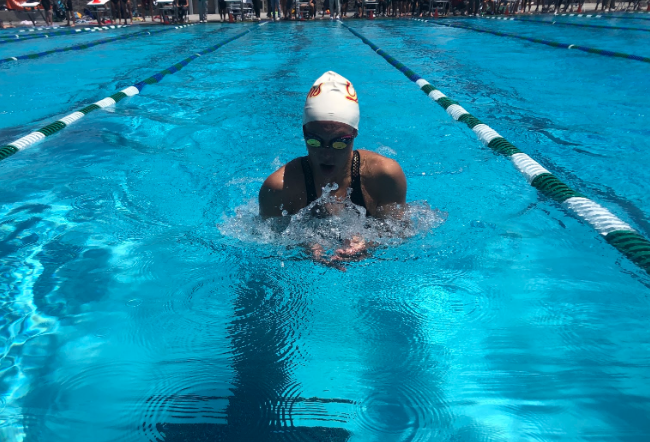 Catie Pentlarge '20 swims into the third wall of her 100-yard breaststroke at the Division 2 CIF Finals, where she finished third overall with a best time of 1:04.41, which qualifies her for the state meet and another opportunity to represent Cathedral Catholic High School.