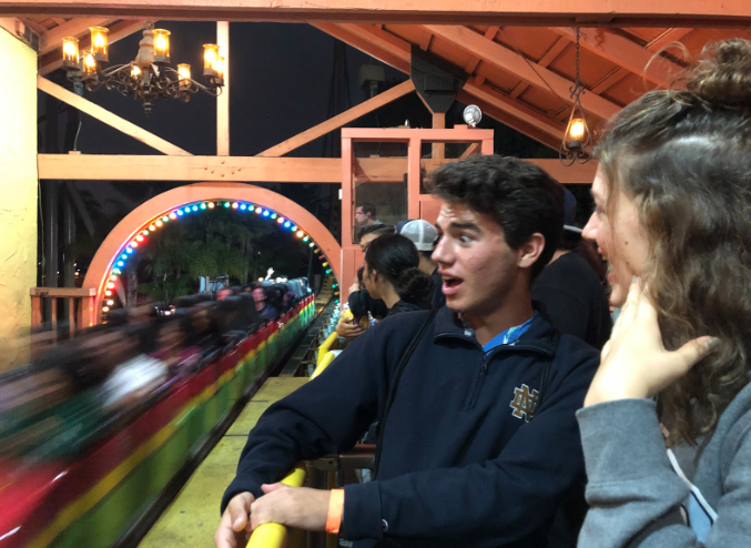Daniel Pronko '19 and Megan Monroe '19 watch as a rollercoaster zooms by at Knotts Berry Farm Saturday night. As one of many graduation events, the CCHS class of 2019 traveled up to Knott's Berry Farm to spend time at the amusement park, even getting special after-hours access from 10 p.m. to 12 a.m.