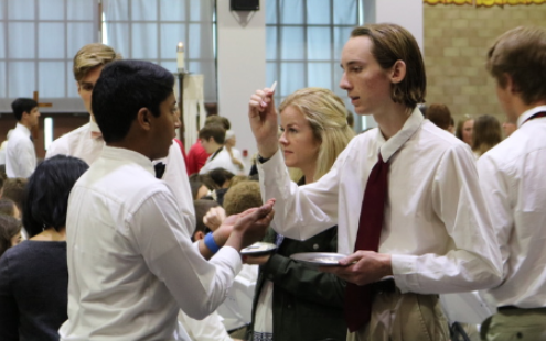 Campus Ministers distribute the Eucharist to fellow classmates during one of many bimonthly all-school Masses.
