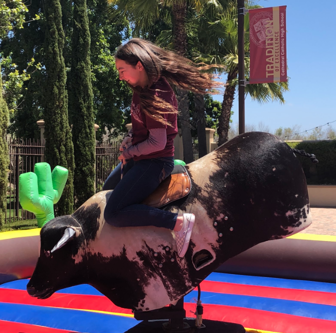 Marie Temprendola '19 rides the mechanical bull during Friday's spring carnival, where approximately 40 CCHS groups were featured with booths, games, and activities.