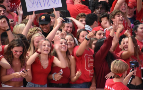 Cathedral Catholic's Student Section Los Locos cheers on the varsity football team last Friday at Manchester Stadium. Los Locos is now headed by the Class of 2020 and continue to carry on the tradition of a energetic, supportive student section.