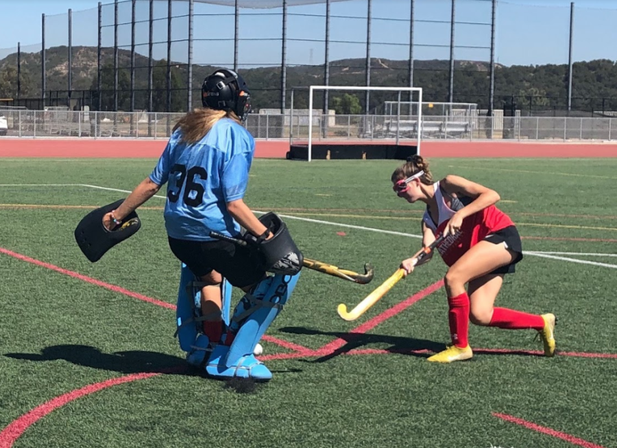 JV field hockey player Abby Kiil '23 goes up against keeper Kendall D'Ascoli '21 before the team's first scrimmage Wednesday.
