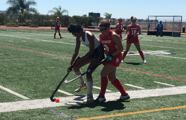 Riley Cox '23 jabs at the ball during the varsity field hockey game against Sage Creek High School in the Valley Center tournament on Saturday. The Dons will advance in the seventh seed to play again next Saturday.