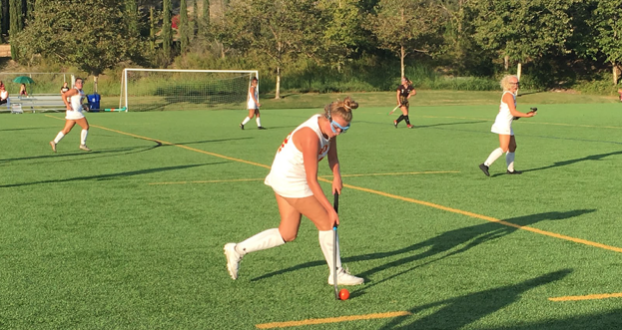 Laney Schmitz '22 dribbles the ball along the sideline in the varsity field hockey game against El Capitan High School on Wednesday, when the Dons went on to win 5-1.
