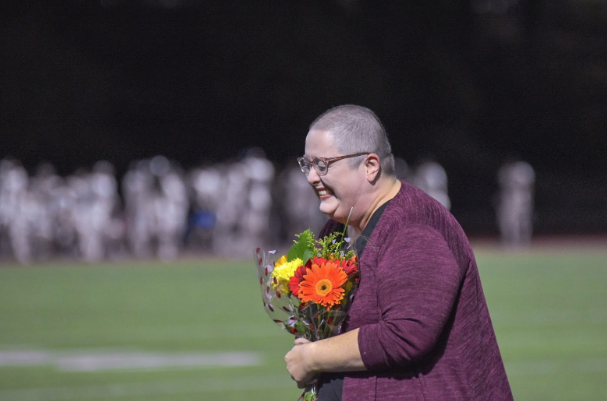 Los Locos congratulated Miss Katie Wilson for winning her battle with cancer in front of the student section during halftime of a football game last October.