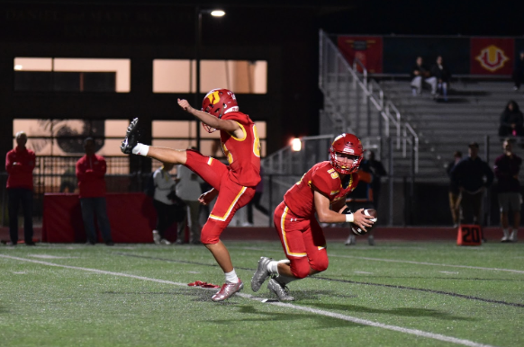 Colman Smith '21 (right) and Trevor Wahl '20 (left) fake a field goal in the homecoming game against Point Loma. This was the first field goal fake of the season and was performed once CCHS was ahead of Point Loma High School by a reasonable amount.