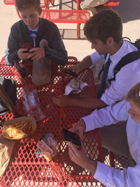 CCHS seniors elect to use their phones rather than interact during lunch, knowing their phone-use is no longer prohibited.