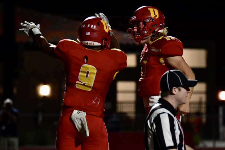 Zavien Watson '20 (left) and DJ Ralph '20 (right) celebrates after scoring the Don's first touchdown.