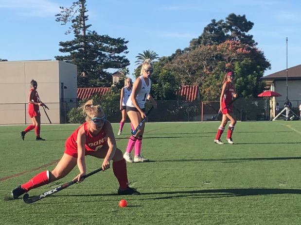 Ashley Hammod '21 sweeps the ball during the varsity field hockey game at The Bishop's School Thursday, when the team lost 4-0.
