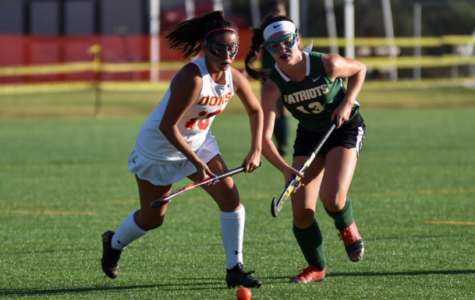 Mia Koczur '21 (left) fights for the ball in the Don's field hockey match against Patrick Henry High School last November. The Dons lost the game 2-0, and both points were scored in the second half of regulation.