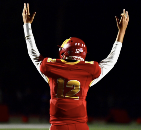 Cathedral Catholic High School varsity football team quarterback, Charlie Mirer '22 throws his hands in the air after a comeback victory against Western League rival, Saint Augustine High School.