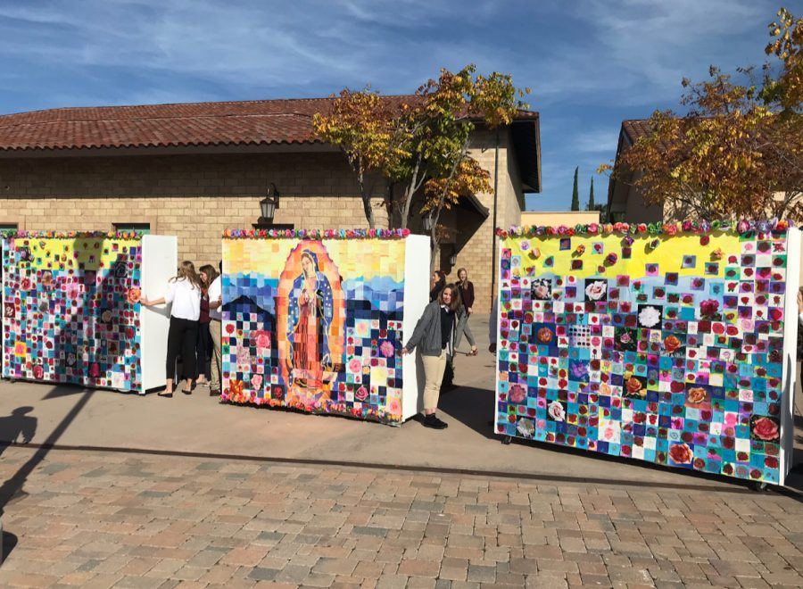 Cathedral Catholic High School students celebrate the feast day of Our Lady of Guadalupe by processing the student-made mural to the chapel during break.