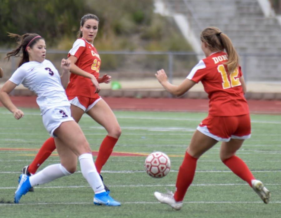 CCHS varsity soccer player Sophia Aragon '21 defends her opponent in the Butch Lee Memorial Tournament against St. Margaret's High School, a game in which CCHS won 3-0.