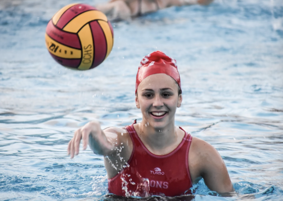 Varsity+water+polo+player+Madeline+McMahon+%2723+throws+the+ball+during+warm-ups+before+a+match.