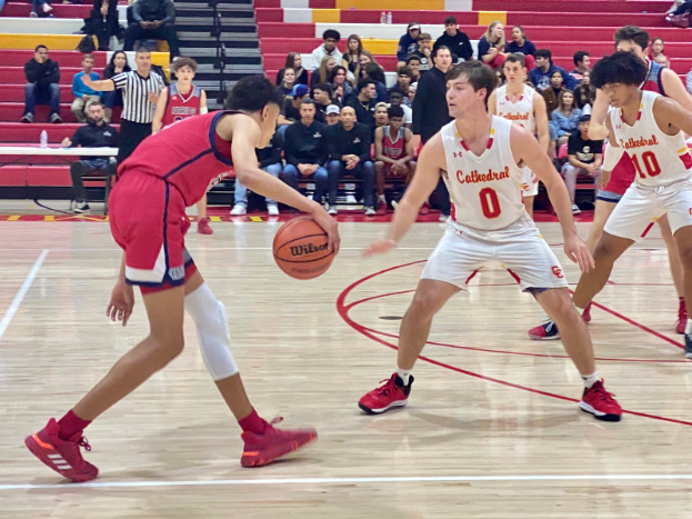 Thomas Notarainni '21 guards a Christian High School player during Friday's varsity basketball home game. The Dons won 71-56, altering their record to 15-5-0 overall and 3-0-0 in league.