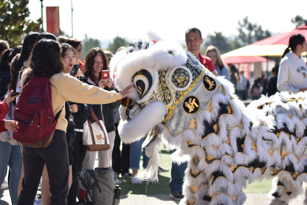 A Cathedral Catholic High School student pets the celebratory dragon during the Chinese New Year festival in January. This event marked beginning of Catholic Schools week, when each day honored a specific ethnic group from around the world. CCHS aimed to incorporate all backgrounds to educate students on the different types of world cultures that are present at CCHS.