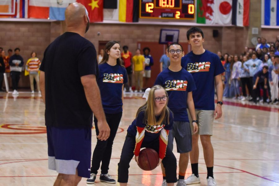 Options student Gabrielle  Schlador '23 shoots a basket during the options versus faculty basketball game at Friday's rally.